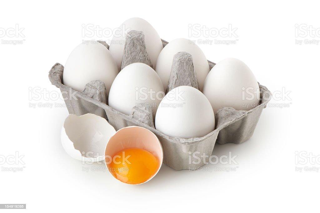 Full six egg carton with a broken egg beside it stock photo