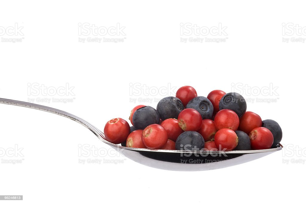 full spoon of blueberries and cranberries royalty-free stock photo