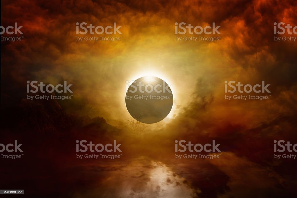 Full sun eclipse in dark red sky, end of world stock photo