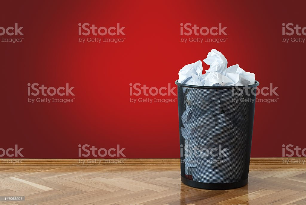 Full wastepaper basket stock photo
