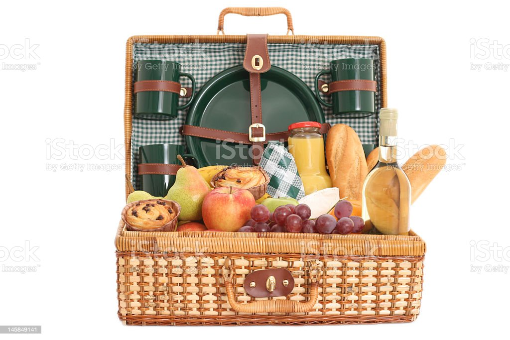 Full wicker picnic basket on white background royalty-free stock photo