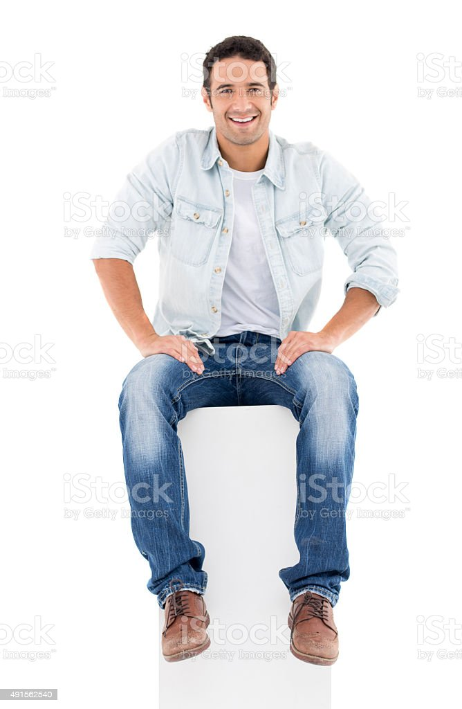 Fullbody casual man sitting stock photo