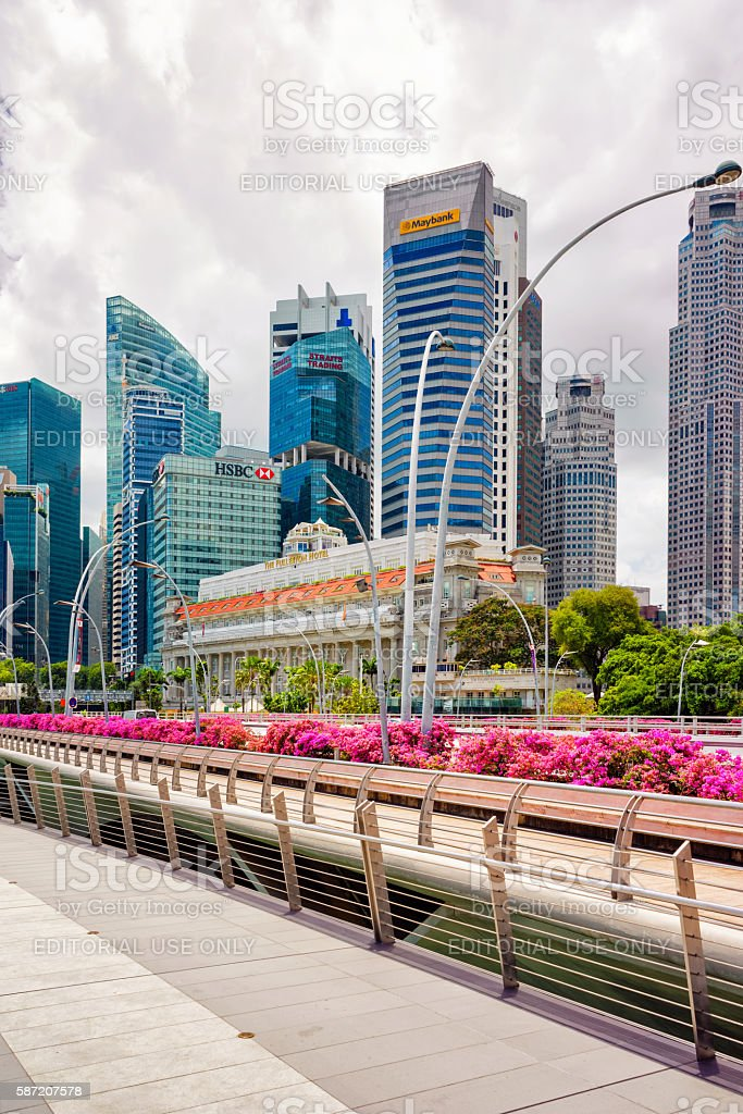 Fullerton hotel building and Jubilee Bridge at Marina Bay Singapore stock photo