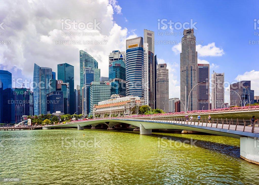 Fullerton hotel building and Jubilee Bridge in Marina Bay Singapore stock photo