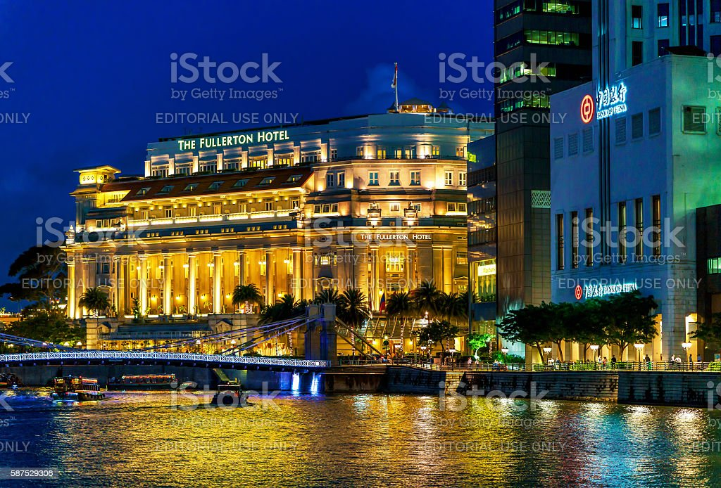 Fullerton hotel building at Marina Bay in Singapore at night stock photo