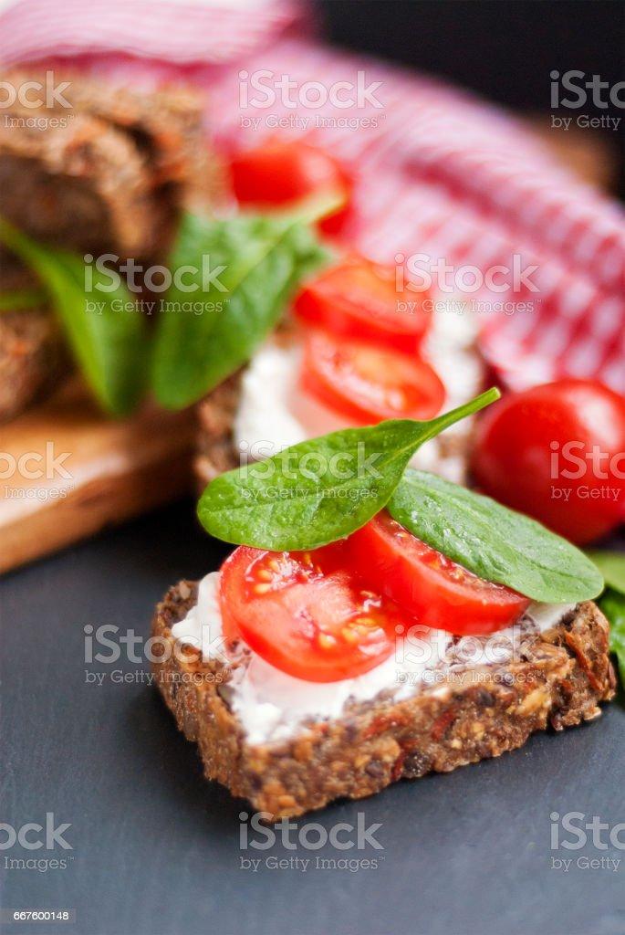 Full-Grained, glutenfree bread with almond cream cheese stock photo
