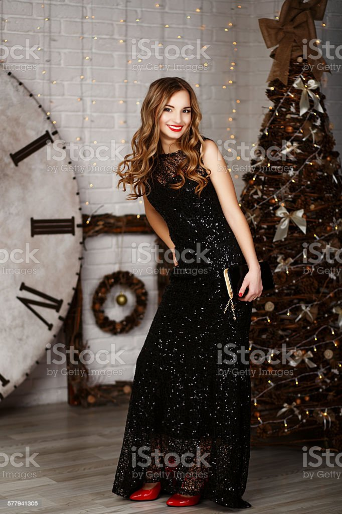 full-length Portrait of a beautiful long-haired young girl in bl stock photo