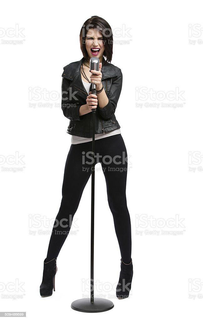 Full-length portrait of rock singer with mic stock photo