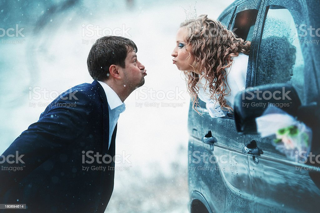 Fun and funny couple married in the winter stock photo