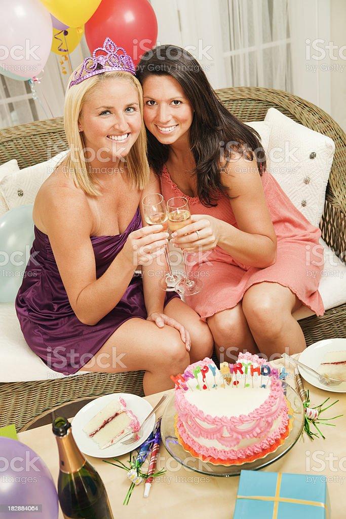 Fun Birthday Party Celebration: Two Women Friends, Cake, Champagne Toast royalty-free stock photo