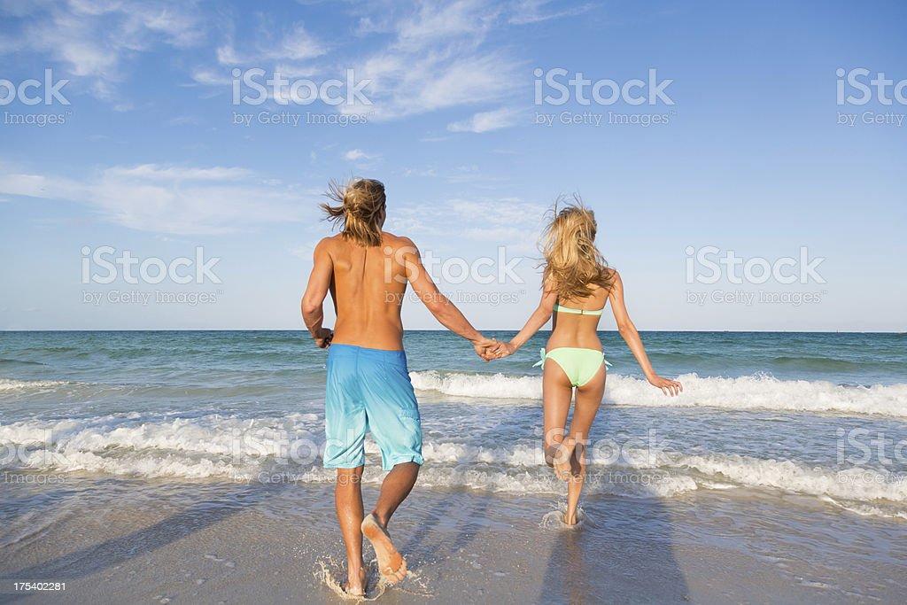 Fun couple at the beach royalty-free stock photo