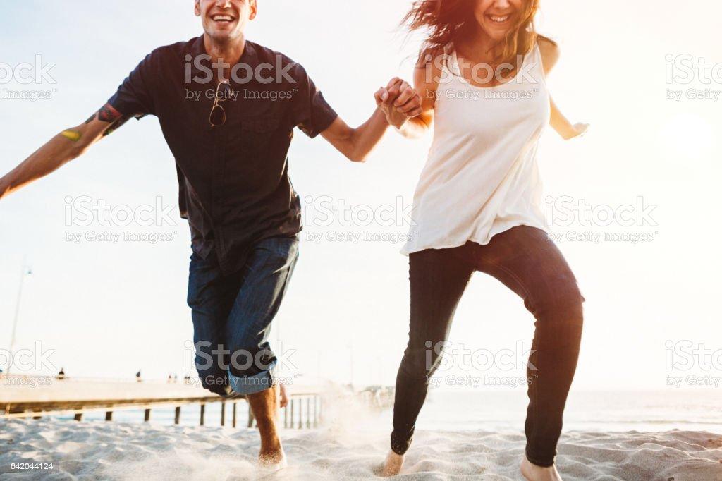 Fun Couple Playing Outdoors stock photo