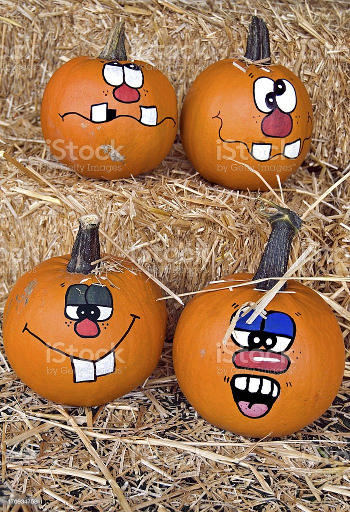 fun faces on fall pumpkins royalty-free stock photo