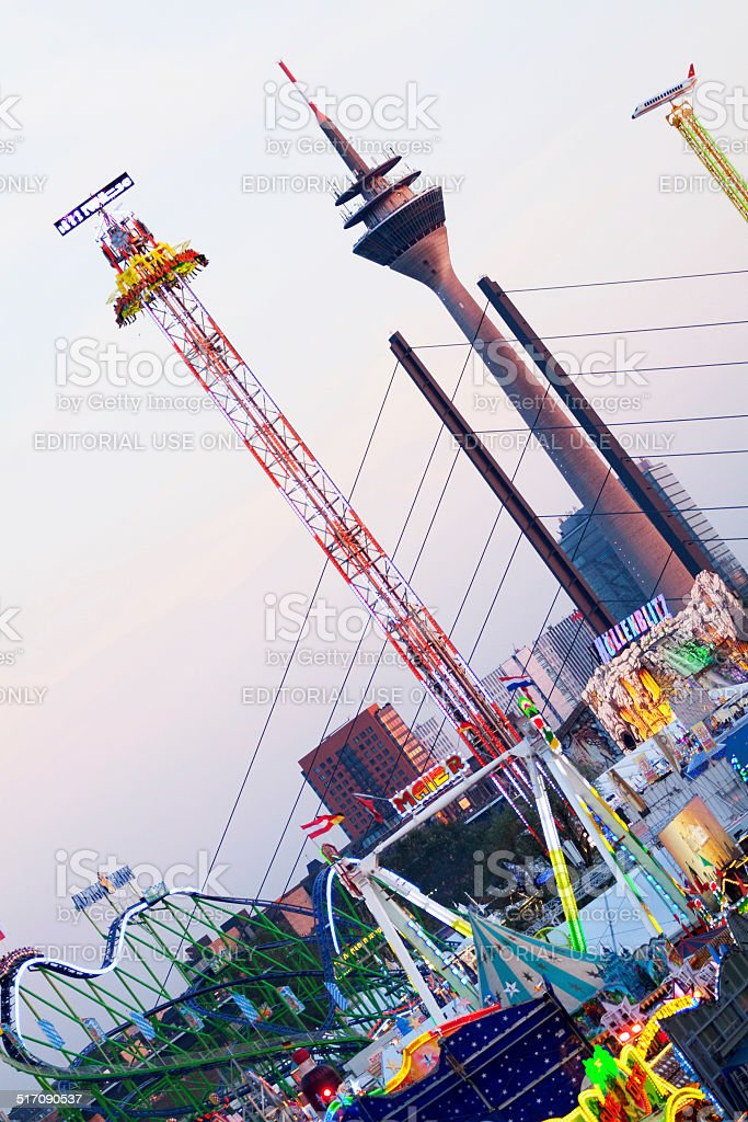 Fun fair attractions in sunset stock photo