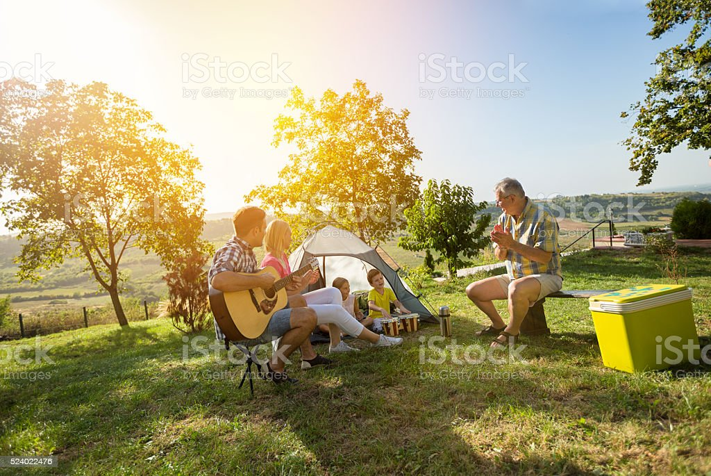 fun family camping stock photo