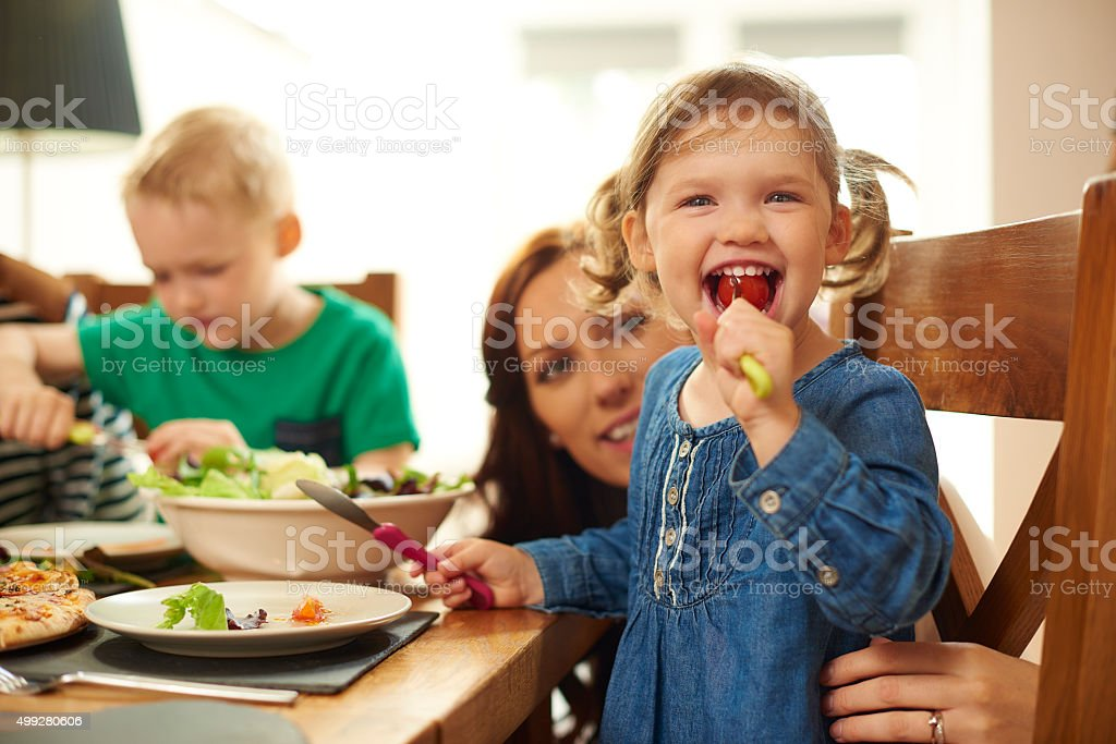 fun family mealtime stock photo