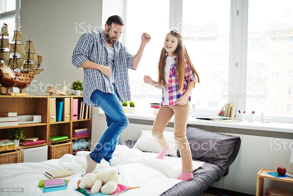 Fun in bedroom stock photo