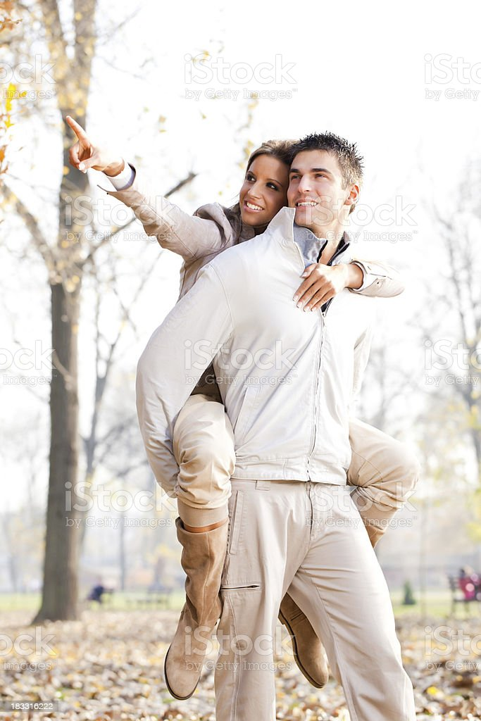 Fun in the park of beautiful couple. royalty-free stock photo