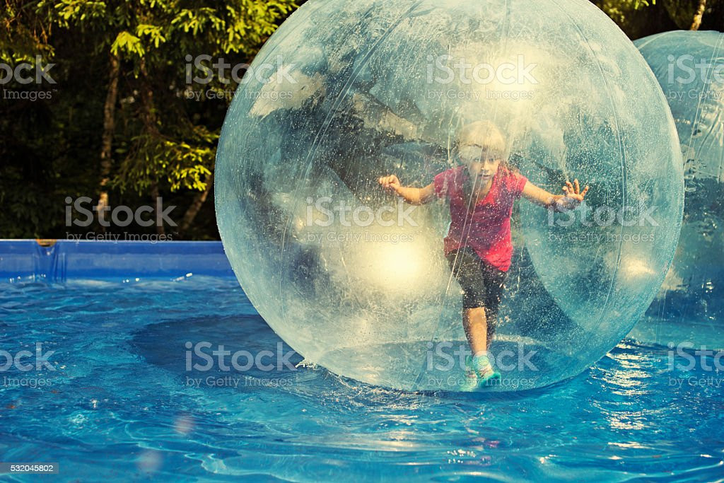 Fun inside a water sphere stock photo