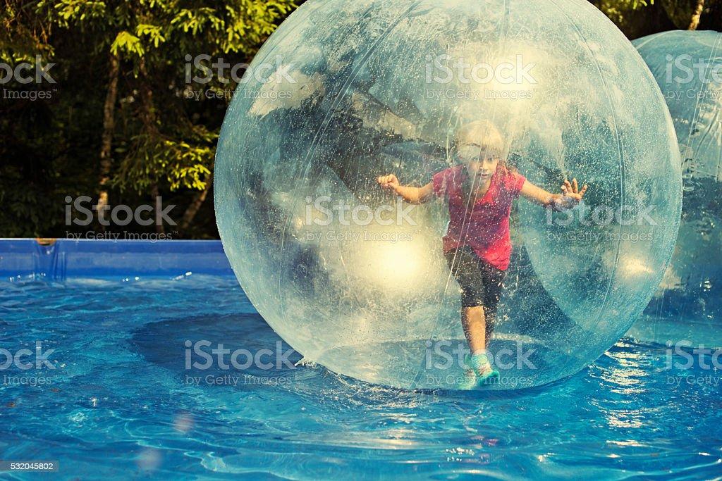 Fun inside a water sphere stock photo