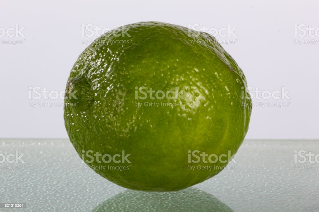 Fun Lime on Plain Background with Reflection stock photo