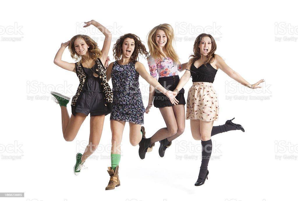 Fun Loving Jumping Young Teen Girls on White Background stock photo