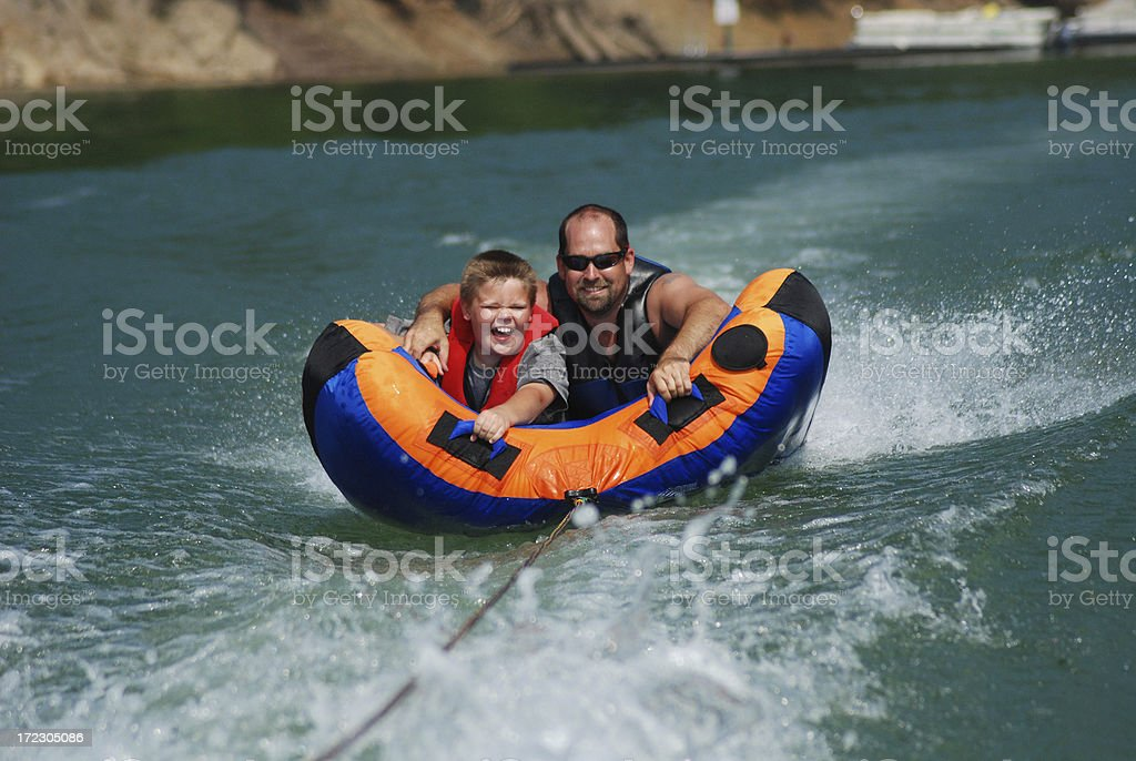 Fun on a Tube with my Dad stock photo