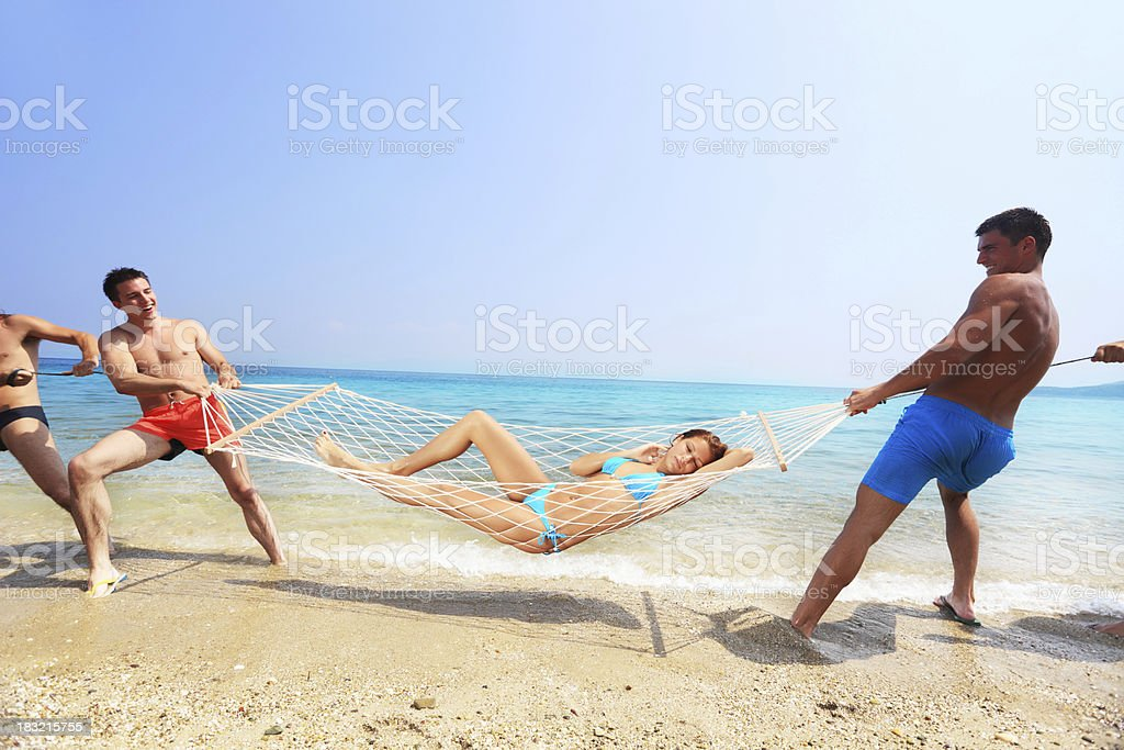 Fun on the Beach with Five Friends royalty-free stock photo