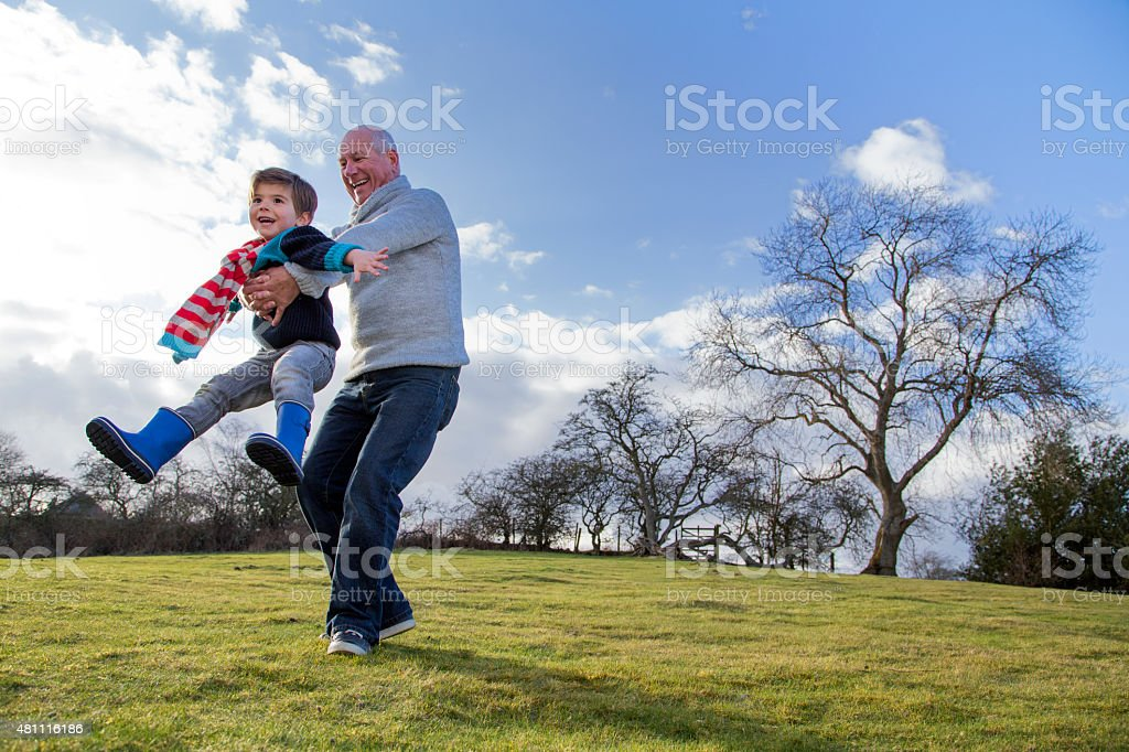 Fun Outdoors with Grandpa stock photo