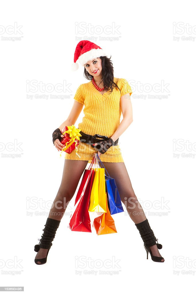Fun santa woman with christmas gifts and packages royalty-free stock photo