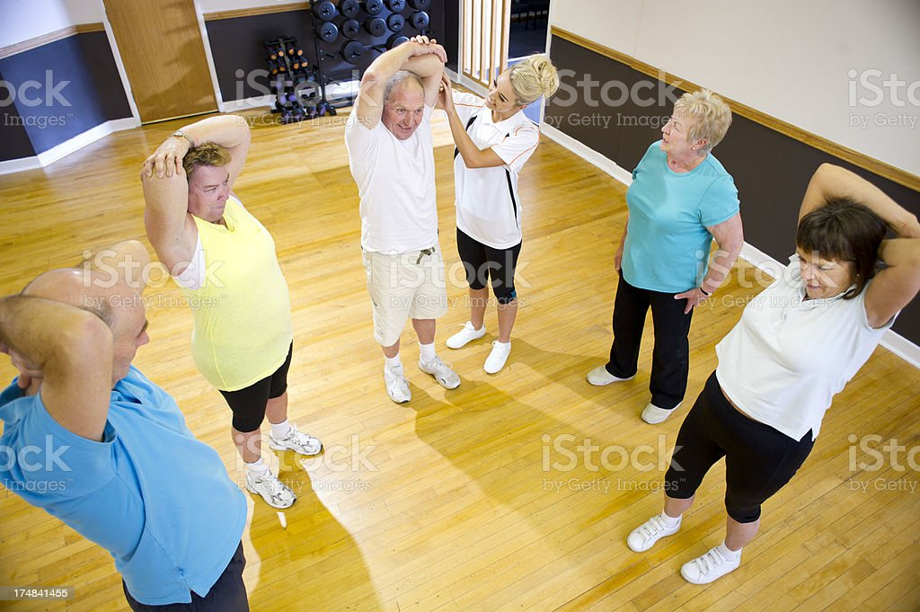 fun senior gym stretching royalty-free stock photo