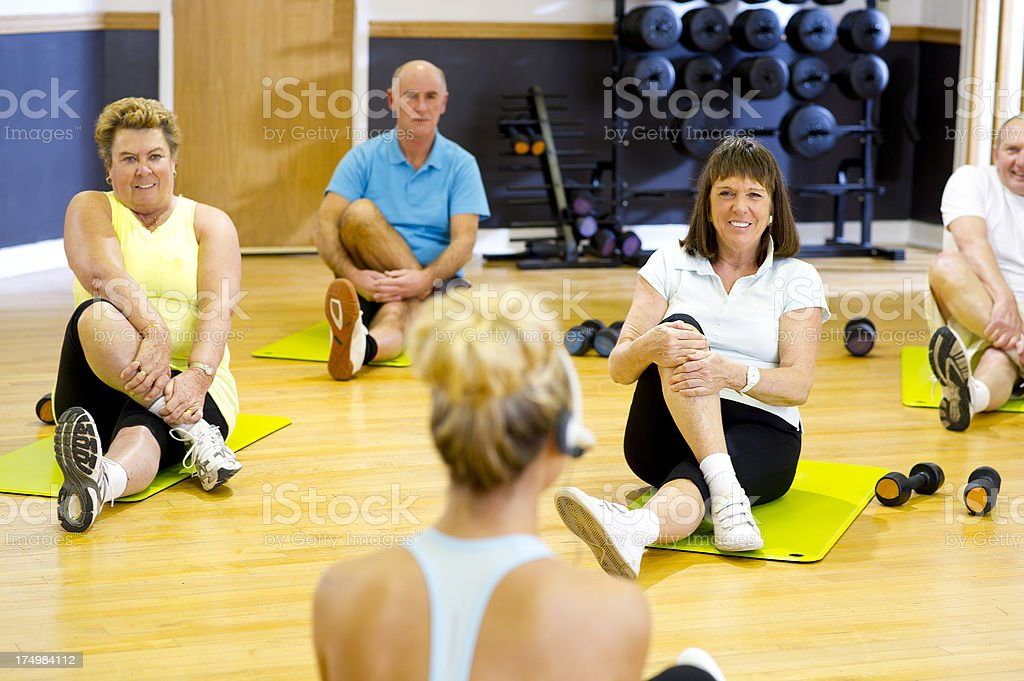 fun seniors step aerobics instructor with class royalty-free stock photo