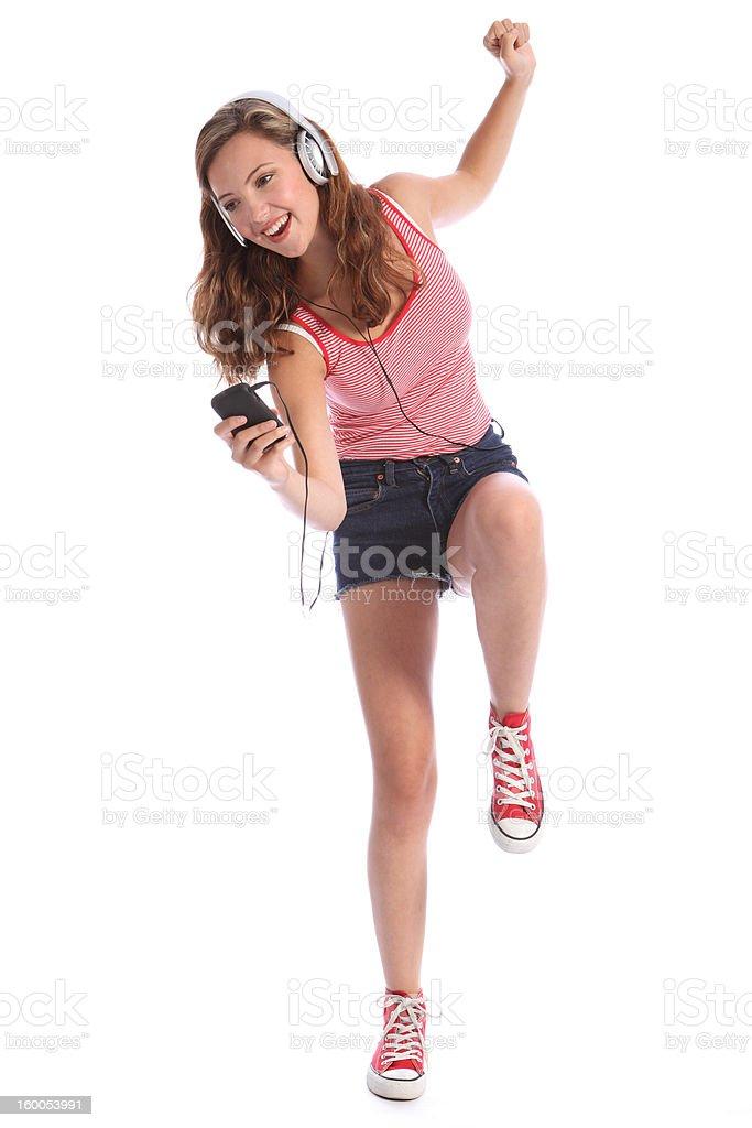 Fun teenage girl dancing with energy to music royalty-free stock photo