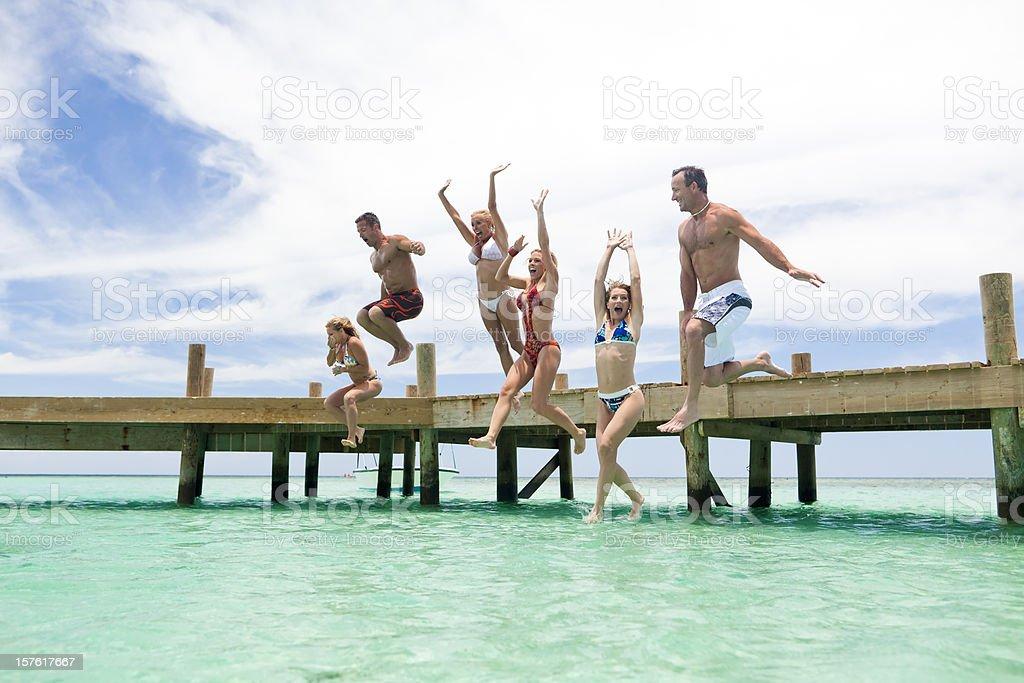 Fun time jumping into sea stock photo