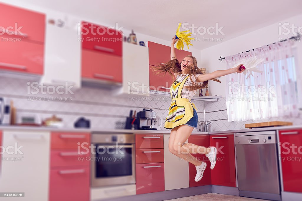 fun while cleaning the kitchen stock photo