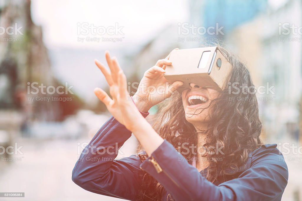 Fun with cardboard virtual reality simulatop stock photo