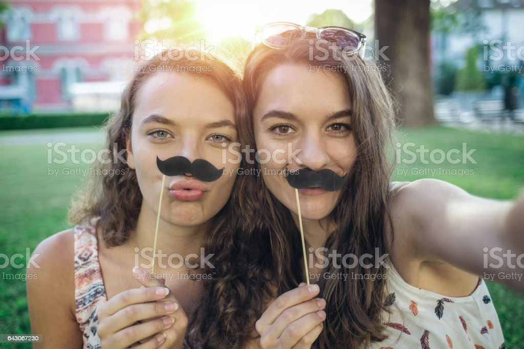Fun with fake mustaches stock photo