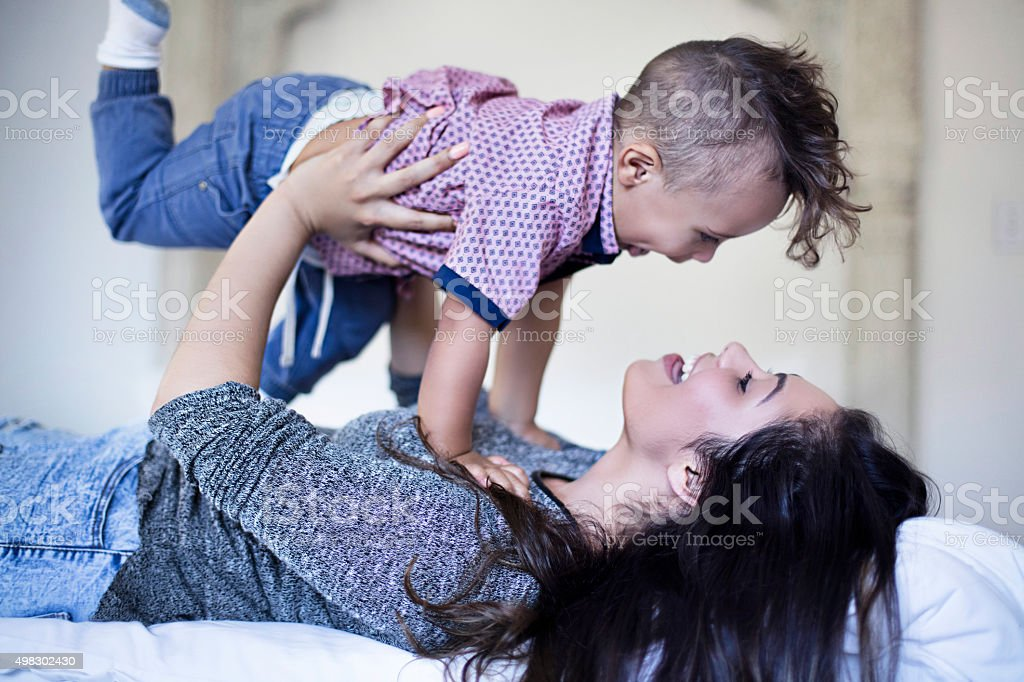 Fun with his mother stock photo
