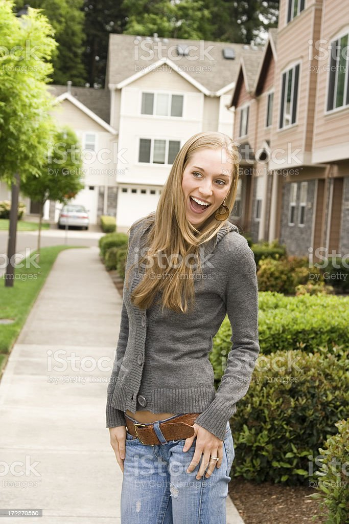 fun young lady in a neighborhood royalty-free stock photo