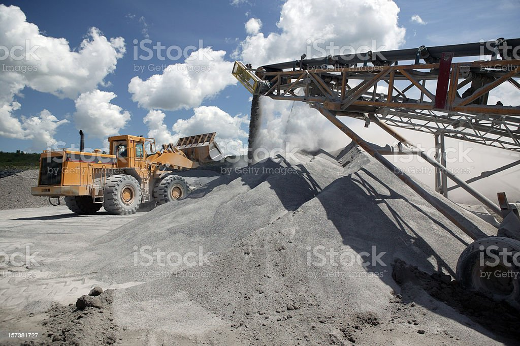Functioning industrial quarry with trucks at work stock photo