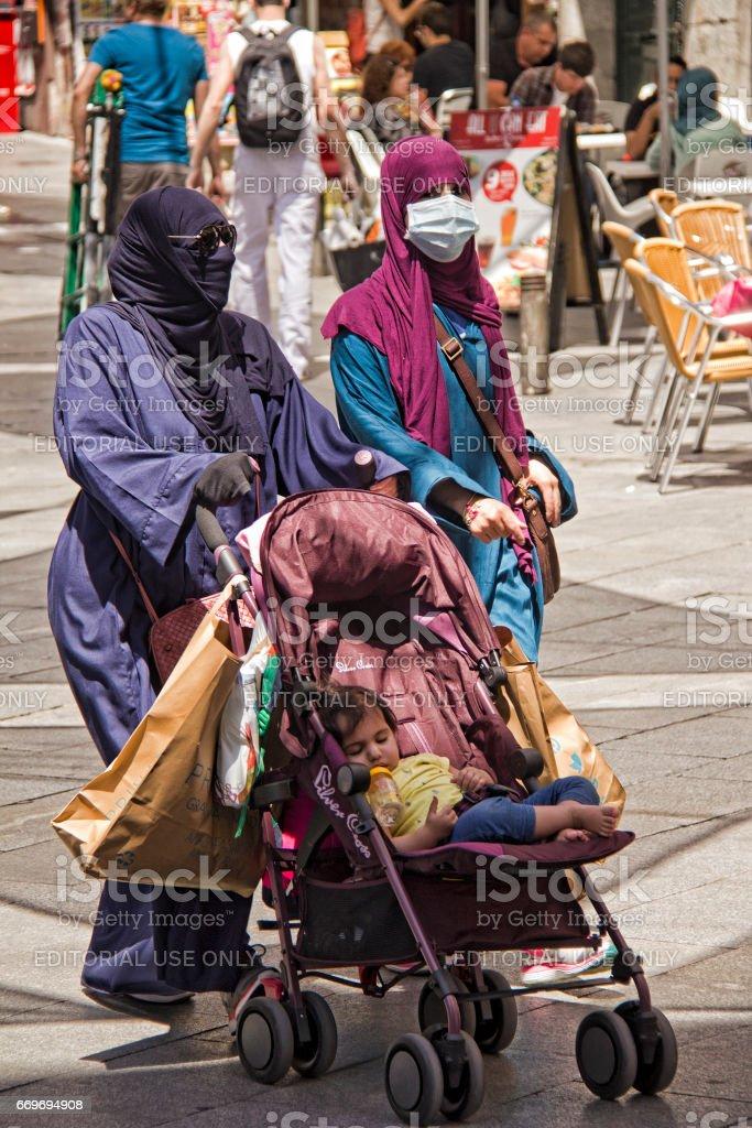 Fundamentalist muslim women shopping stock photo
