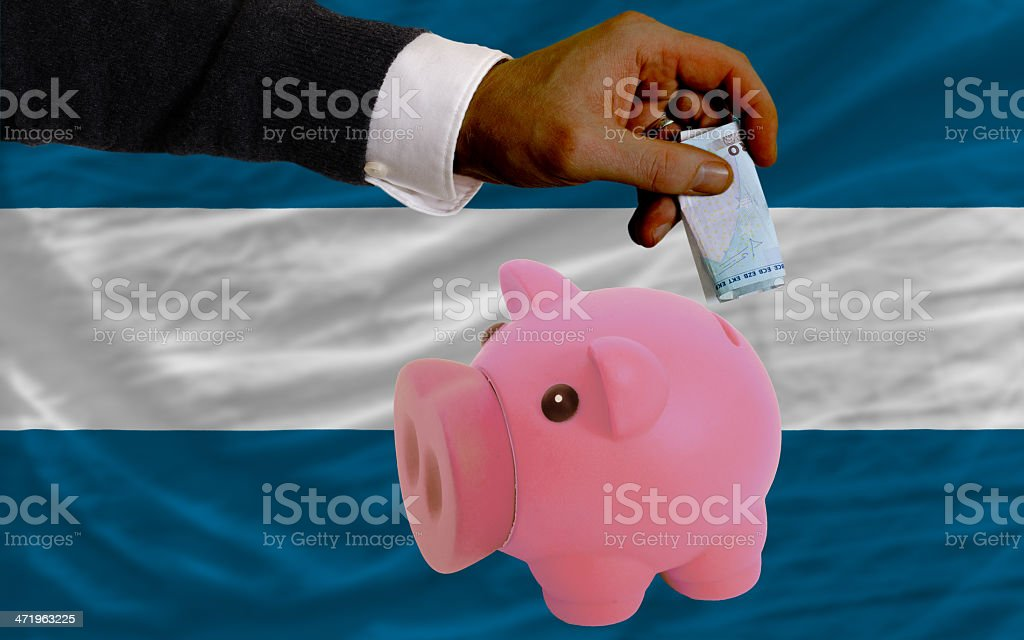 Funding euro into piggy rich bank flag of el salvador stock photo