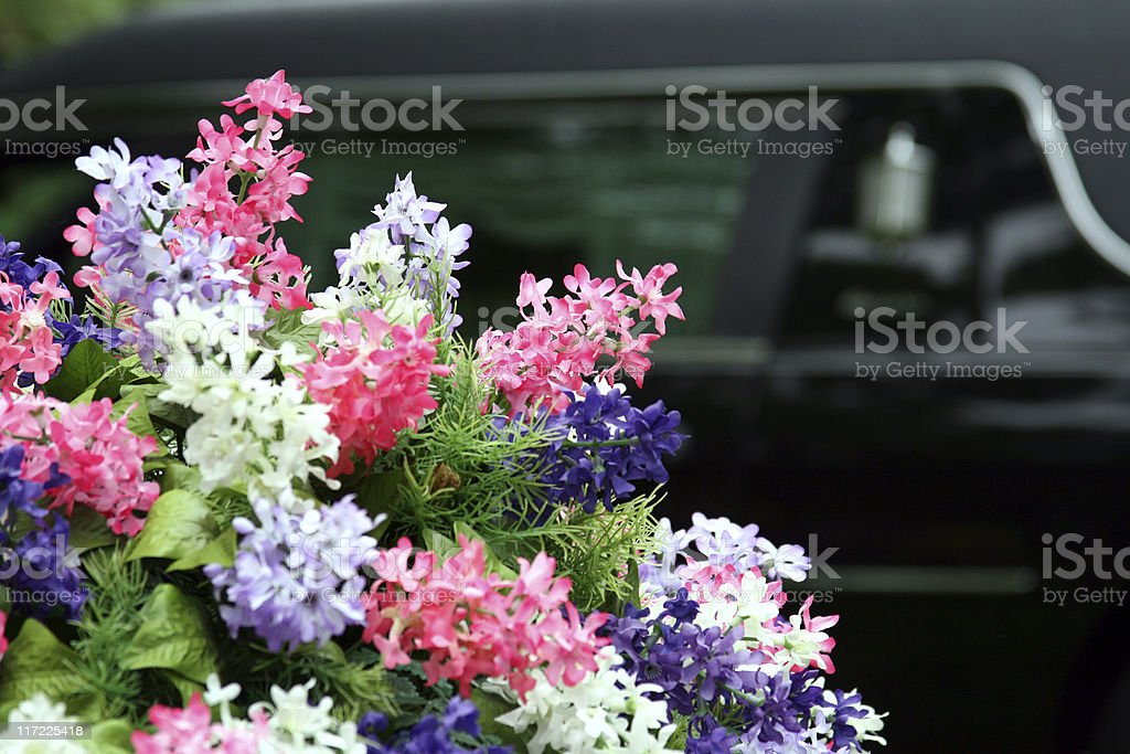 Funeral Flowers and Hearse with Copy Space stock photo