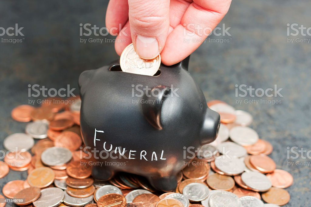 Funeral Piggy Bank on Coins stock photo