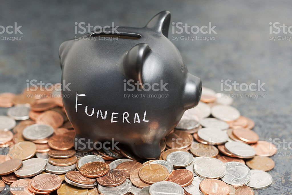 'Funeral' Piggy Bank on Coins stock photo