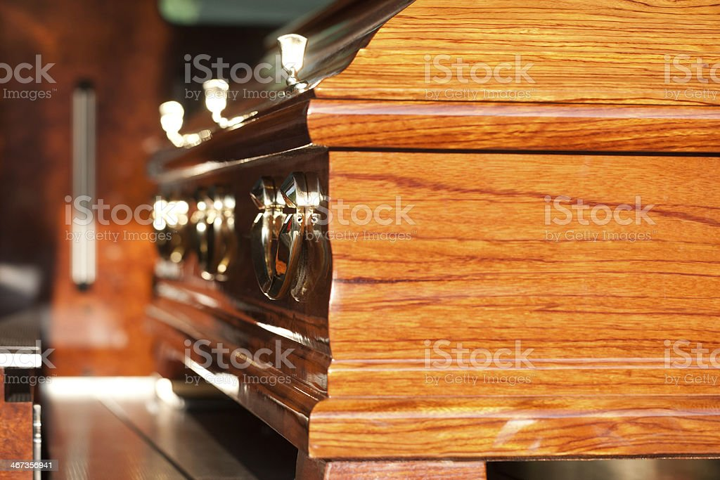 Funeral with coffin in hearse stock photo