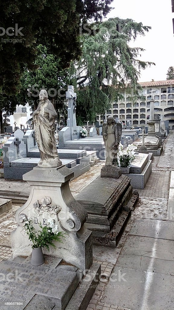 Funerary sculptures in a  burial ground . stock photo