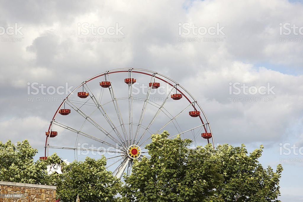 Funfair ride ferris wheel section against sky royalty-free stock photo
