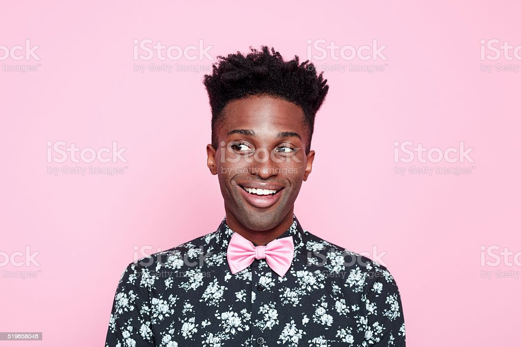 Funky afro american guy against pink background stock photo