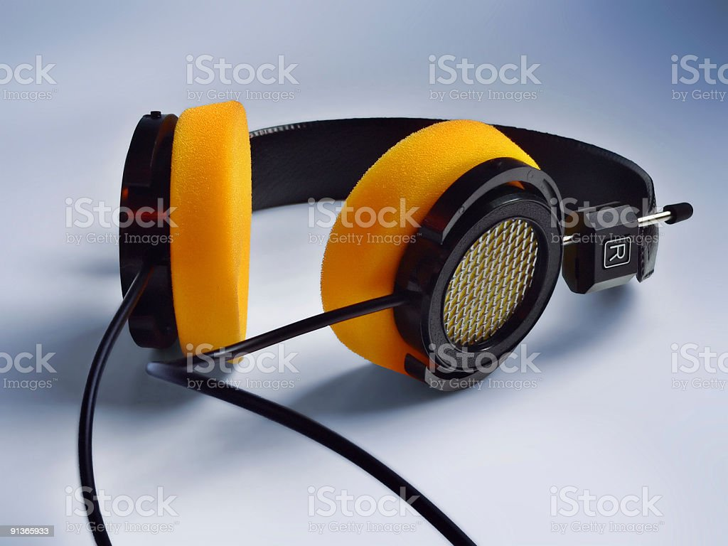 Funky Custom Headphones With Yellow Ear Muffs and Metal Grill stock photo